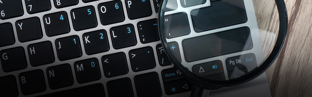 Magnifying glass investigation laptop header 1600x700.jpg